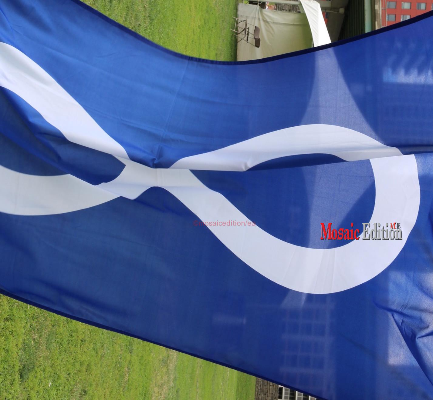 Todd Ross in addition explains the flag of the Métis Nation.   The blue flag is the flag of the Métis Nation of Ontario representing water and the blue sky.