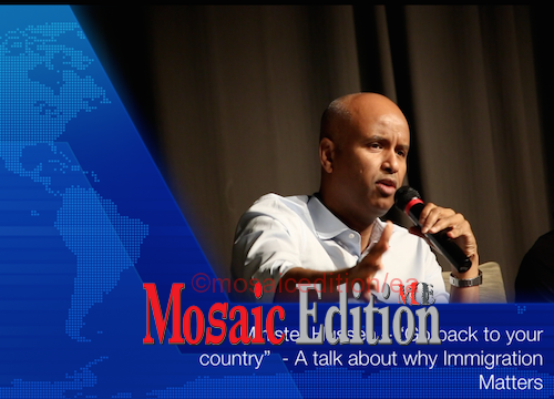 "Minister Hussen – ""Go back to your country"" - A talk about why Immigration Matters - Video Screenshot-mosaicedition.ca-ea"