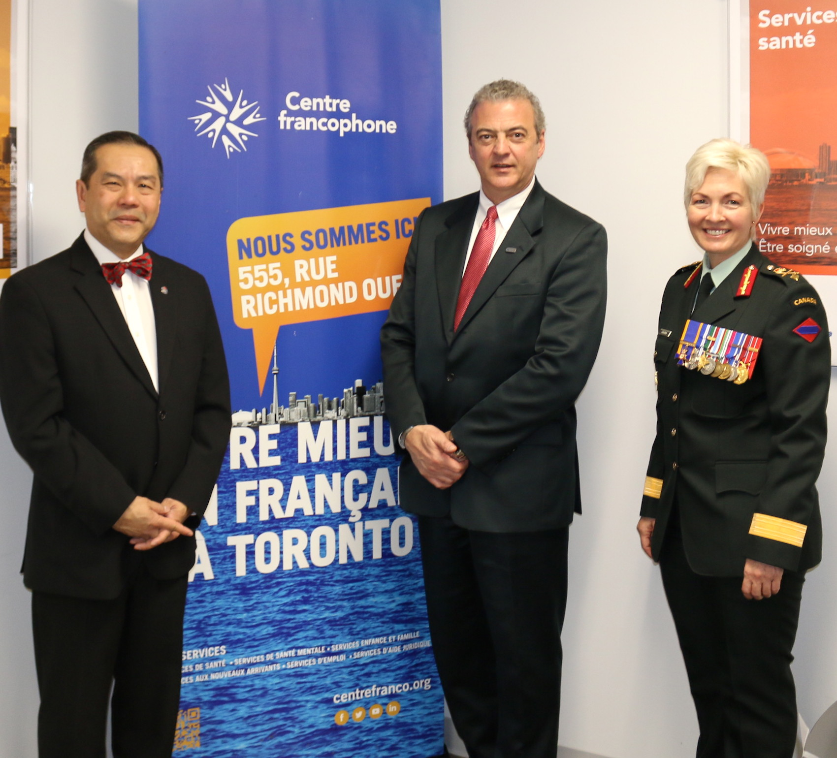 Albert Wong , Citizenship Judge for the Greater Toronto Area, René C Viau - Vice Chair Board Of Directors Centre francophone de TorontoRené and Brigadier-General Jennie Carrignan- Chief of Staff Operations Canadian Army at the National Flag of Canada 53rd anniversary.