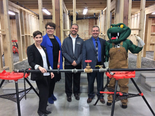 Michaud, VP – Academic at Collège Boréal, Anthony Davies, Owner of Greater Sudbury Plumbing, Daniel Giroux, Collège Boréal President and the college's mascot, La Vipère. - photo supplied